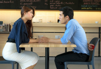 Concept Couples  activities in the coffee shop,man propose woman