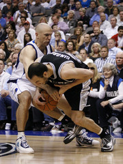 Mavericks guard Kidd ties up Spurs guard Ginobili before being called for a foul during Game 1 of their NBA Western Conference series in Dallas