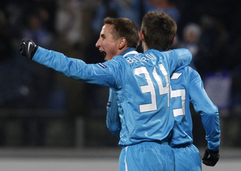 Zenit St. Petersburg's Semak celebrates with teammate Bystrov after scoring against Benfica during their Champions League last 16 first leg soccer match at the Petrovsky stadium in St. Petersburg