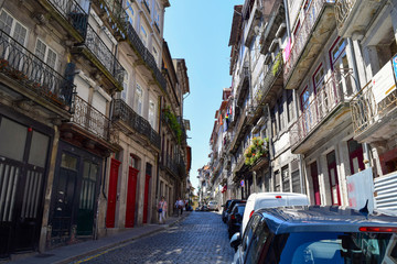 Unidentified people walk through the narrow streets of Ribeira in Porto, Portugal