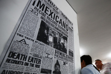 A poster is seen on a wall during an exhibition of the Guinness World Record collection of Harry Potter memorabilia at the Mexican Museum of Antique Toys in Mexico City