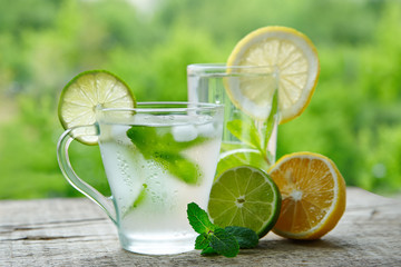 A cold drink made of lemon, lime and mint outdors