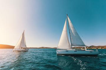 Wall Mural - Sailing yachts at the Aegean Sea at sunset. Luxury boats.