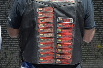 A biker sports patches from past events as he pauses at the Vietnam Veterans Memorial during Rolling Thunder XXVII on Memorial Day weekend in Washington