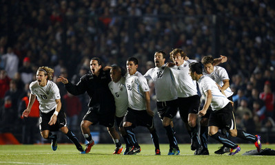 Uruguayan players celebrate after their victory by penalty kicks against Argentina in their quarter-final soccer match at the Copa America in Santa Fe