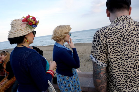 German pin-up Steiner, dressed in fifties-style outfit, smokes a cigarette as she and her friends attend the 22th Rockin' Race Jamboree International Festival in Torremolinos