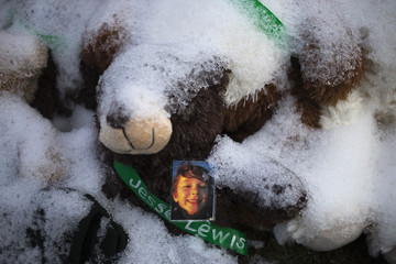 An image of six-year-old Jesse McCord Lewis, one of 20 schoolchildren killed in the December 14 shootings at Sandy Hook Elementary School, sits on a snow-covered teddy bear on Christmas morning in Newtown, Connecticut