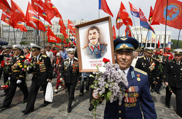 War veterans march through the centre of Kiev on Victory Day