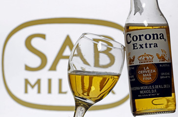 A glass with beer and a bottle of Corona are seen in this picture illustration taken in Sarajevo