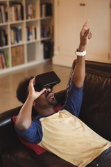 Man using virtual reality headset in the living room