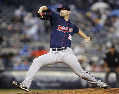 Minnesota Twins' Diamond pitches to New York Yankees during their MLB baseball game in New York