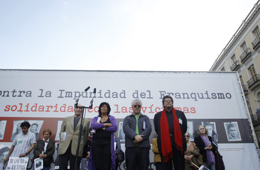 Spanish writer Grandes , Spanish film director Almodovar and Human Rights Watch special counsel Brody take a minute of silence in Madrid