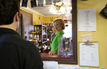 U.S. presidential candidate and former Secretary of State Hillary Clinton gestures describing the size of her tea order as she campaigns for the 2016 Democratic presidential nomination at the Jones Street Java House in LeClaire