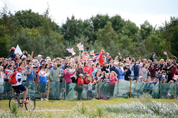 Supporters cheer during the rowing event of the London 2012 Olympic Games at Eton Dorney