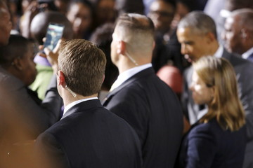 Secret Service agents guard U.S. President Barack Obama as he greets attendees after a town hall meeting with young Caribbean leaders at the University of the West Indies in Kingston, Jamaica