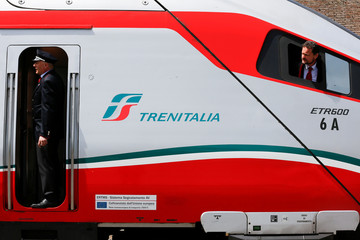 Trenitalia's conductors look before to leave by  Frecciargento's train at the Vatican railway station in Vatican