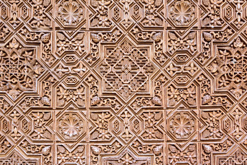 Background  of arabic decoration in plaster. Alhambra of Granada.