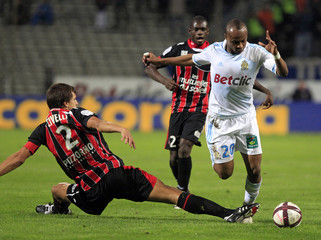 Olympique Marseille's Ayew challenges Nice's Civelli during their French Ligue 1 soccer match at the Velodrome stadium in Marseille