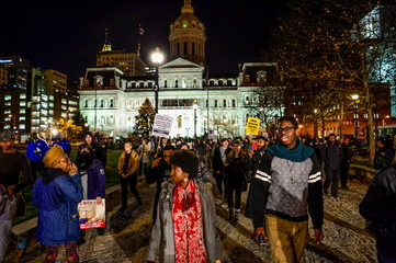 Protesters march at city hall in Baltimore