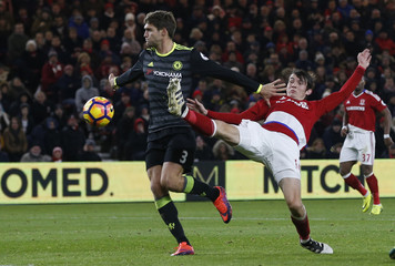 Chelsea's Marcos Alonso in action with Middlesbrough's Marten de Roon