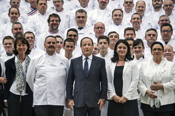 French President Hollande and pastry chefs pose in the gardens of the Hotel de Marigny for the Pastry Day celebration in Paris