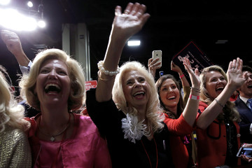 Supporters of Republican U.S. presidential nominee Donald Trump cheer as Trump takes the stage at a campaign rally in Charlotte