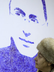 """Woman visits an exhibition called """"To execute, not to pardon"""", dedicated to the announcement of a verdict in a second trial of jailed Russian oil tycoon Khodorkovsky, in Moscow"""