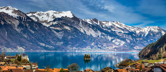 Beautiful panoramic view of blue lake in Iseltwald, Switzerland Wall mural