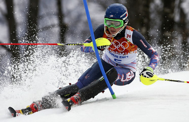 Shiffrin of the U.S. clears a gate during the first run of the women's alpine skiing slalom event at the 2014 Sochi Winter Olympics