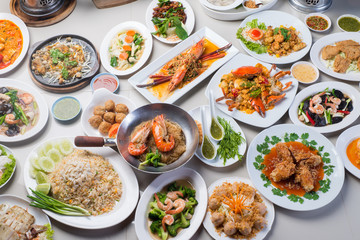 seafood in Restaurant, white plate on the Table with side dish, group many variety of meal, top view
