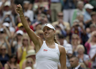 Angelique Kerber of Germany reacts after defeating Maria Sharapova of Russia in their women's singles tennis match at the Wimbledon Tennis Championships, in London