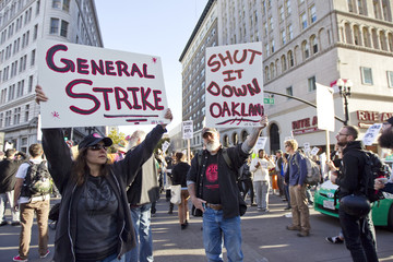 Anti-Wall Street protesters stop traffic in downtown streets in Oakland