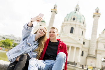 Dating young couple happy in love taking selfie self-portrait photo in Vienna