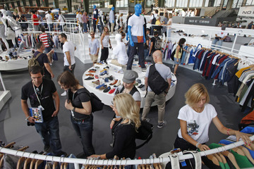People look at clothes in the Addidas pavilion at Bread and Butter fashion trade show in Berlin