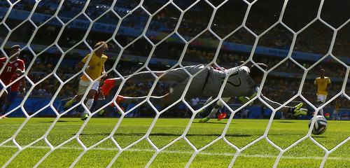 Chile's Sanchez scores a goal against Brazil's goalkeeper Cesar during their 2014 World Cup round of 16 game at the Mineirao stadium in Belo Horizonte