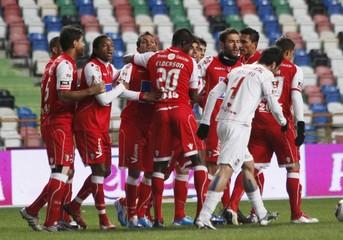 Sporting Braga players celebrate a goal against Leiria during their Portuguese Premier League soccer match at Leiria City stadium