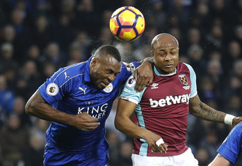 Leicester City's Wes Morgan in action with West Ham United's Andre Ayew