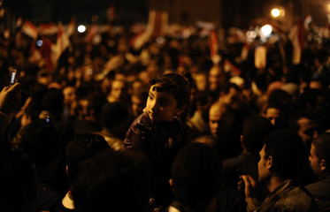 Anti-government protesters in Cairo's Tahrir Square wait to hear President Hosni Mubarak's address to the nation