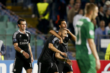 Bale, Benzema and Arbeola of Real Madrid celebrate after Benzema scored a goal during their Champions League Group B soccer match against Ludogorets at Vassil Levski stadium in Sofia