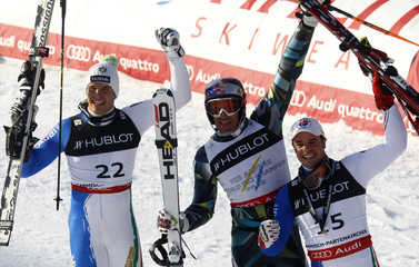Innerhofer of Italy Svindal of Norway and Fill of Italy react after the race in the slalom portion of the men's super combined race at the Alpine Skiing World Championships in Garmisch-Partenkirchen