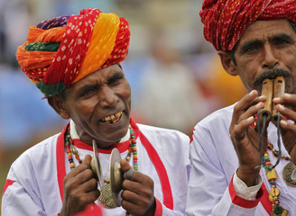 Indian performers play traditional instruments as they take part in India's Independence Day celebrations at Ajmer