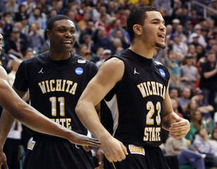 Wichita State Early and guard Vleet react after a play during the second half of their third round NCAA tournament basketball against Gonzaga game in Salt Lake City, Utah