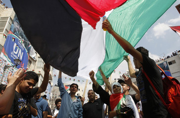 Palestinians attend a rally in the West Bank city of Ramallah