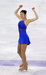 South Korea's Kim gestures after performing in women's free skating figure skating event at Vancouver 2010 Winter Olympics