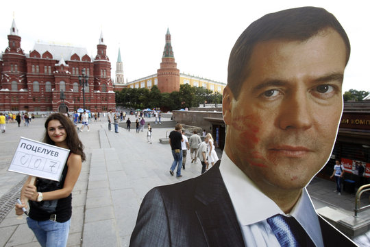 A board showing Russia's President Medvedev covered in lipstick stains is displayed during an event marking International Kissing Day in central Moscow