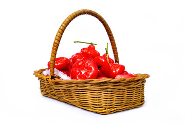 Rose apple, red fruit in the wicker basket, isolate on white background