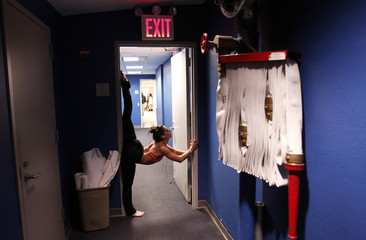 Daniels stretches backstage at the US Pole Dance Championships before the competition in New York City