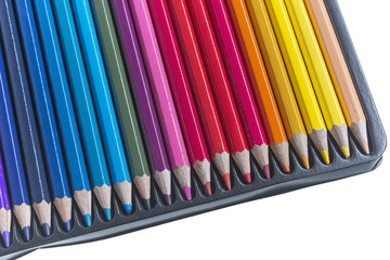 Box with colored pencils on white background