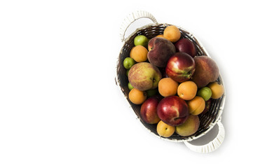 White background with a basket of peaches, plums, apples, nectarines, apricot pictures