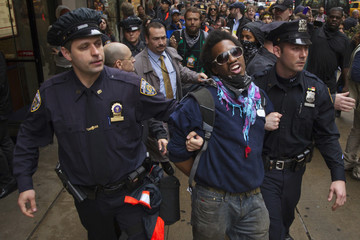 An Occupy Wall Street movement activist is arrested by police during a march through midtown Manhattan